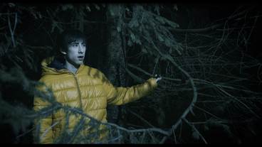 Scene from the Swiss film TRUE DARK. Starring Mai Oki and Manfred Liechti. Finding out of the creepy forest. Shot by Alex Boutellier