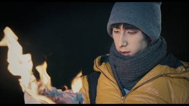 Scene from the Swiss film TRUE DARK. Starring Mai Oki and Manfred Liechti. Burning term paper. Shot by Alex Boutellier